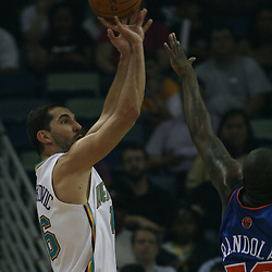 Peja Stojakovic #16 shoots over Zach Randolph #50 of the New York Knicks  on April 4, 2008 at the New Orleans Arena in New Orleans, Louisiana. New Orleans Hornets defeated the New York Knicks 118-110 and with the win clinched a NBA Playoff birth.