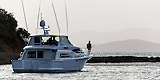Vanquish, anchoring in Harris Bay, Bon Accord Harbour, Kawau Island, Hauraki Gulf, Auckland.