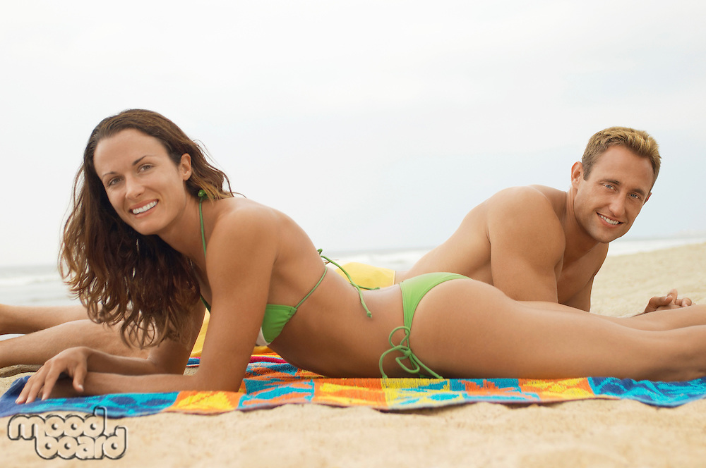 Couple Lying Down Together on Beach