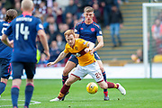 Danny Johnson (#24) of Motherwell FC holds off Jimmy Dunne (#3) of Heart of Midlothian during the Ladbrokes Scottish Premiership match between Motherwell and Heart of Midlothian at Fir Park, Motherwell, Scotland on 15 September 2018.