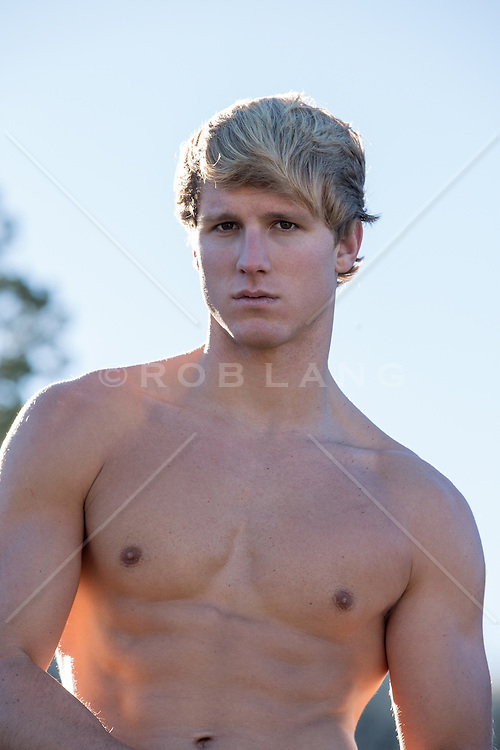 shirtless hunk with blond hair outdoors