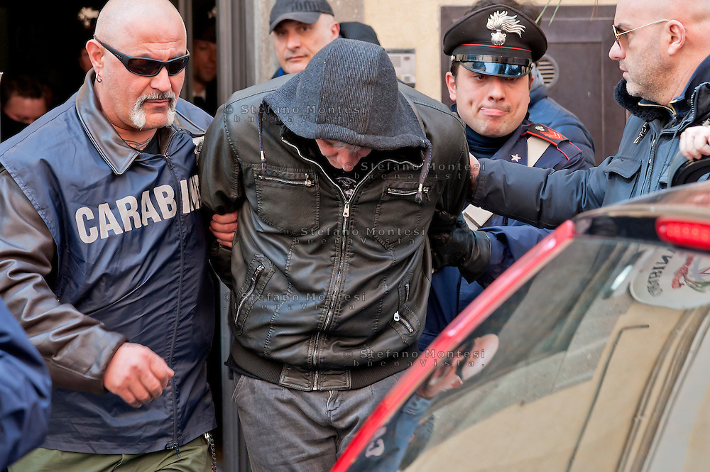 """One of the 24 arrested by Carabinieri.<br /> The Carabinieri of the Rome Provincial Command  have arrested 23 people suspected of being part of a group dedicated to robbery in the house.  At the head of the criminal group Manlio Vitale, said """"er Gnappa"""", formerly of the Magliana gang. About 200 Carabinieri, with the help of sniffer dogs and a helicopter, they performed arrests, searches and seizures in the entire province of Rome. Rome Italy. 15th March 2016"""