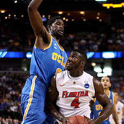 Mar 19, 2011; Tampa, FL, USA; Florida Gators center Patric Young (4) is defended by UCLA Bruins center Anthony Stover (0) during first half of the third round of the 2011 NCAA men's basketball tournament at the St. Pete Times Forum.  Mandatory Credit: Derick E. Hingle
