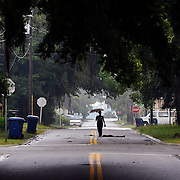 A woman is seen carrying an umbrella while walking down Monson Street in Beaufort on June 23, 2014.