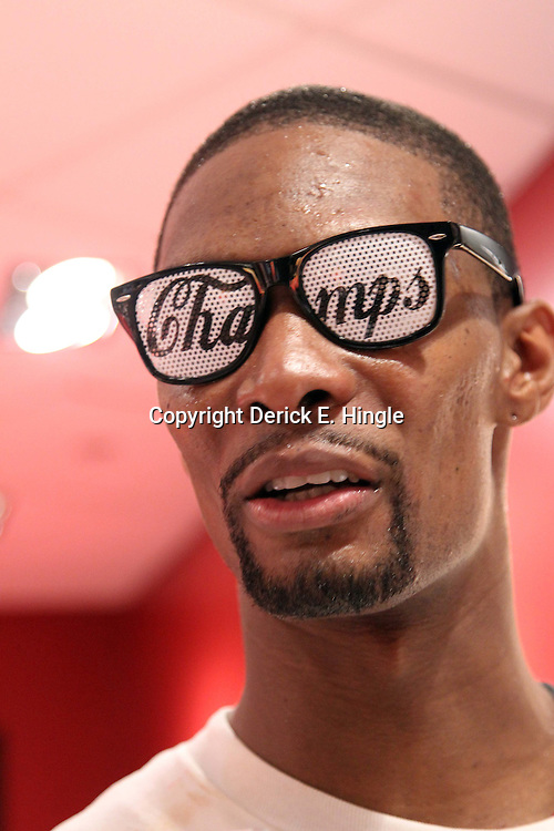 Jun 21, 2012; Miami, FL, USA; Miami Heat power forward Chris Bosh celebrates in the locker room after winning the 2012 NBA championship at the American Airlines Arena. Miami won 121-106. Mandatory Credit: Derick E. Hingle-US PRESSWIRE