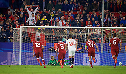 SEVILLE, SPAIN - Tuesday, November 21, 2017: Liverpool's goalkeeper Loris Karius dives  to his right and is beaten from the penalty spot, but the referee orders it to be re-taken during the UEFA Champions League Group E match between Sevilla FC and Liverpool FC at the Estadio Ramón Sánchez Pizjuán. (Pic by David Rawcliffe/Propaganda)