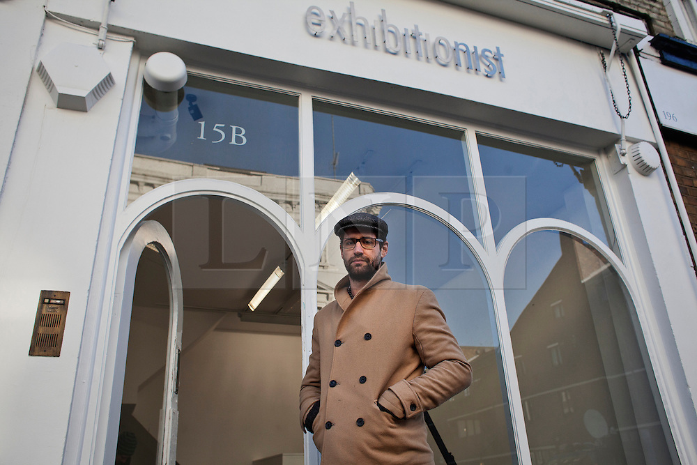 """© Licensed to London News Pictures. 11/12/2013. London, United Kingdom. Nathan Engelbrecht, owner of the gallery """"Exhibitionist"""" in 15b Blenheim Crescent London. Two of artist Damien Hirst's paintings were stolen from the gallery. Photo credit : Andrea Baldo/LNP"""