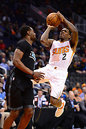 Jan 30, 2017; Phoenix, AZ, USA; Phoenix Suns guard Eric Bledsoe (2) shoots the ball in front of a Memphis Grizzlies defender in the second half of the NBA game at Talking Stick Resort Arena. The Memphis Grizzlies won 115-96. Mandatory Credit: Jennifer Stewart-USA TODAY Sports
