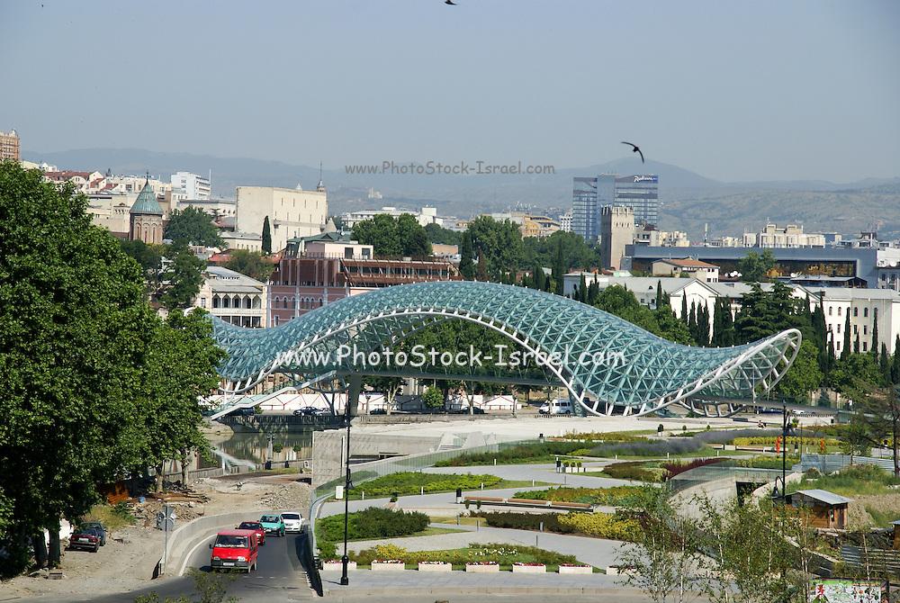 Georgia, Tbilisi, view of the city and Kura (Mtkvari) river The modern pedestrian bridge