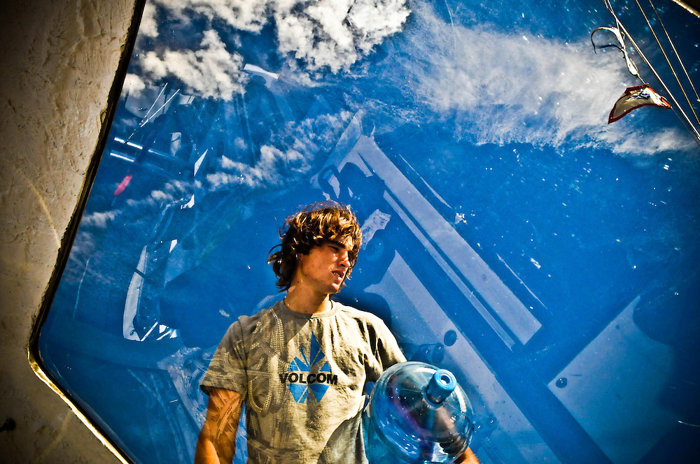 16 year old Zac Sunderland loads more water onto his boat in Majuro in the Marshall Islands, Tuesday afternoon, Aug 5, 2008. Zac is preparing for his next leg at see where he will be sailing over 3,000 miles to Darwin, Australia.