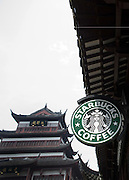 A Starbucks coffee shop in Shanghai's central Yu Yuang gardens, a popular tourist destination. Starbucks, which has more than 200 outlets in China, opened a shop in 2000 in Beijing's Forbidden City, which served as the imperial palace for the Ming Dynasty (1368-1644) and the Qing Dynasty (1644-1912). But calls are mounting among Chinese to remove the outlet, saying its presence is besmirching the historical location.