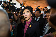 "09 JANUARY 2105 - BANGKOK, THAILAND:  YINGLUCK SHINAWATRA, former Prime Minister of Thailand, walks through a crowd of supporters to a waiting car after presenting her defense during her impeachment at the National Legislative Assembly. Thailand's military-appointed National Legislative Assembly began impeachment hearings Friday against former Prime Minister Yingluck Shinawatra. If she is convicted, she could be forced to stay out of politics for five years. During her defense, Yingluck questioned the necessity of her impeachment, saying, ""I was removed from office, the equivalent of being impeached, three times already, I have no position left to be impeached from."" A decision on her impeachment is expected by the end of January.   PHOTO BY JACK KURTZ"