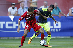Adam Maher of PSV (R) during the friendly match between FC Sion and PSV Eindhoven at Stade St-Marc on July 12, 2017 in Bagnes, Switzerland