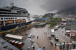 The Holland American Line cruise ship Amsterdam overlooks downtown Juneau in southeast Alaska. Cruise ships traveling the Lynn Canal in southeast Alaska often make a port call in Juneau, the state capital of Alaska.
