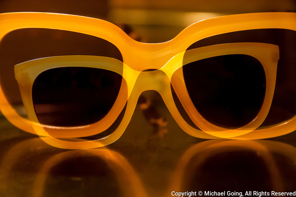 Composite image of two bright yellow framed sun glasses
