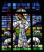 Stained glass image of Jesus, the Good Shepherd, from Allouez Cemetery in Green Bay. (Photo by Sam Lucero)