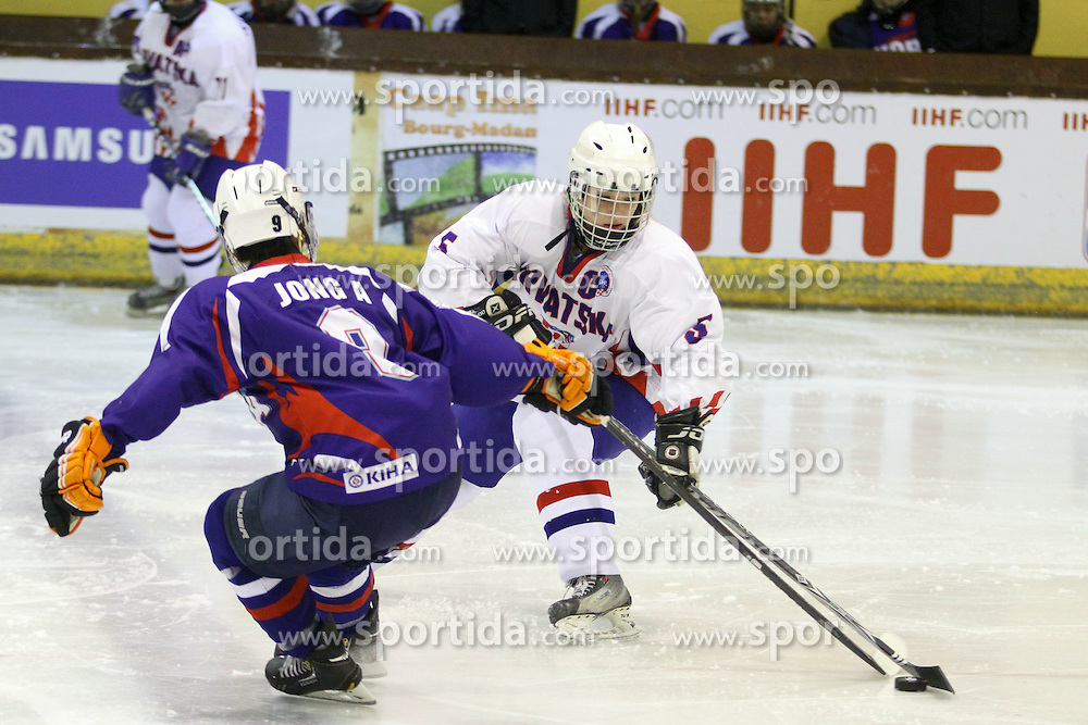 01.04.2013 Puigcerda, Spain. IIHF Ice Hockey Women's World Championship Div II Group B. Picture show Jongah Park (L) and Diana Kruselj Posavec (R) in action during Game between korea against Croatia