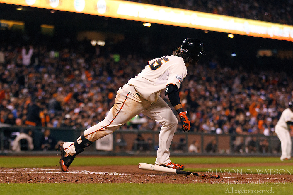 SAN FRANCISCO, CA - MAY 20:  Brandon Crawford #35 of the San Francisco Giants hits an RBI single against the Los Angeles Dodgers during the sixth inning at AT&T Park on May 20, 2015 in San Francisco, California.  (Photo by Jason O. Watson/Getty Images) *** Local Caption *** Brandon Crawford