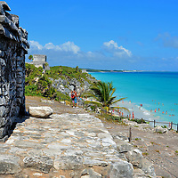 Overlooking Ancient Seaport at Mayan Ruins in Tulum, Mexico <br /> There were numerous Mayan cities within Mesoamerica, a region stretching from central Mexico to Costa Rico. They date from 750 BC until the end of the 17th century. Most of their communities were built inland. This makes Tulum unique for two reasons: it was constructed on a coastline and is the furthest east. Archeologists belief it was a port city for an active marine trade.  Evidence suggests canoes up to 50 feet in length regularly arrived at this seaport.