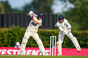 Billy Root of Glamorgan batting and Middlesex wicket keeper John Simpson during the Specsavers County Champ Div 2 match between Middlesex County Cricket Club and Glamorgan County Cricket Club at Radlett Cricket Ground, Radlett, Herfordshire,United Kingdom on 17 June 2019.