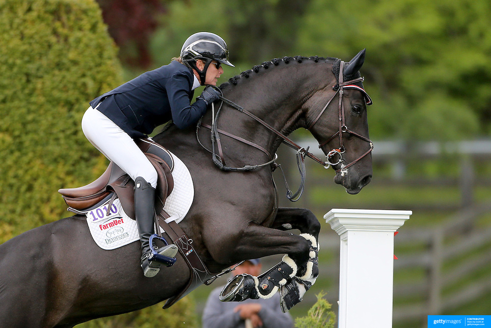 NORTH SALEM, NEW YORK - May 15: Candice S King, USA, riding Azibantos, in action during The $50,000 Old Salem Farm Grand Prix presented by The Kincade Group at the Old Salem Farm Spring Horse Show on May 15, 2016 in North Salem. (Photo by Tim Clayton/Corbis via Getty Images)