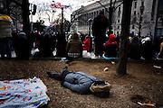 The Inauguration of President Barack Obama. Washington DC, January 20, 2009. A man sleeps while waiting for the parade to start.