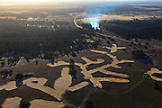 Nederland, Gelderland, Hoge Veluwe, 20-01-2011. Pampelsche  Zand, deel van Nationaal Park de Hoge Veluwe, met hei, vliegdennen en zandverstuivingen. Afgeplagde heide.  gecontroleerd branden. Moorland of the nature area and National Park the Hoge Veluwe. Controlled fires..luchtfoto (toeslag), aerial photo (additional fee required).copyright foto/photo Siebe Swart