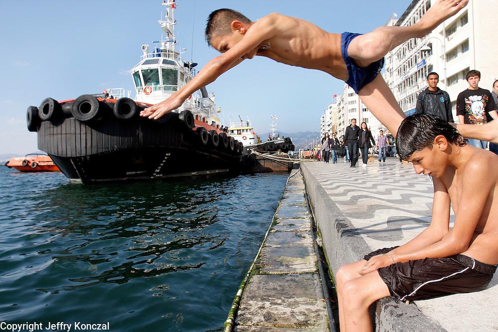 A bot dives into the Bay of Izmir along Kordon walkway in Izmir, Turkey.