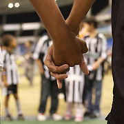 Young Botafogo fans hold hands while creating a guard of honour for the players before the Botafogo V Vasco, Futebol Brasileirao  League match at Estadio Olímpico Joao Havelange, Rio de Janeiro, The classic Rio derby match ended in a 2-2 draw. Rio de Janeiro,  Brazil. 22nd September 2010. Photo Tim Clayton.