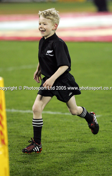 The All Blacks ball boy takes the ball to the field during the 1st test match between the New Zealand All Blacks and the British and Irish Lions at Jade Stadium in Christchurch,New Zealand on Saturday 25 June, 2005. The All Blacks won 21-3.Photo:Andrew Cornaga/PHOTOSPORT<br />