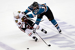 May 18, 2010; San Jose, CA, USA; San Jose Sharks center Patrick Marleau (12) checks Chicago Blackhawks left wing Kris Versteeg (32) during the first period of game two of the western conference finals of the 2010 Stanley Cup Playoffs at HP Pavilion.  The Blackhawks defeated the Sharks 4-2. Mandatory Credit: Jason O. Watson / US PRESSWIRE