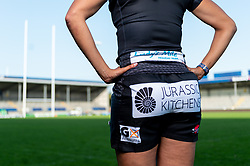 Featured Lady's Mile Holiday Park, Jurassic Kitchens, G X Accountants ; Garnet MacKinder models the new Exeter Chiefs Women's shirt with their new sponsors on ahead of their 2020/21 Season - Mandatory by-line: Ryan Hiscott/JMP - 17/09/2020 - RUGBY - Sandy Park - Exeter, England - Exeter Chiefs Women - Shirt Sponsors Evening