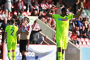 Contrast of emotion from  Jack Munns and Michael Iwiekwe at the final whistle during the Vanarama National League match between Cheltenham Town and Tranmere Rovers at Whaddon Road, Cheltenham, England on 26 September 2015. Photo by Antony Thompson.