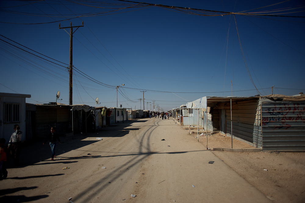 August 08, 2013 - Zaatari, Jordan: General view of a commercial area at Zaatari refugee camp in northern Jordan. The area has nicknamed of Champs Elysees, due to the hundreds of shops and businesses. Zaatari camp, home to more than 120,000 people who in the past year have fled the conflict in Syria, become the fourth largest city in Jordan and the world's second largest refugee camp behind Dadaab in eastern Kenya. Most of its residents came from Daraa, a city about 30Km away in Syria, rich with businessmen thanks to a long history of cross-border trade with Jordan. (Paulo Nunes dos Santos/Al Jazeera)