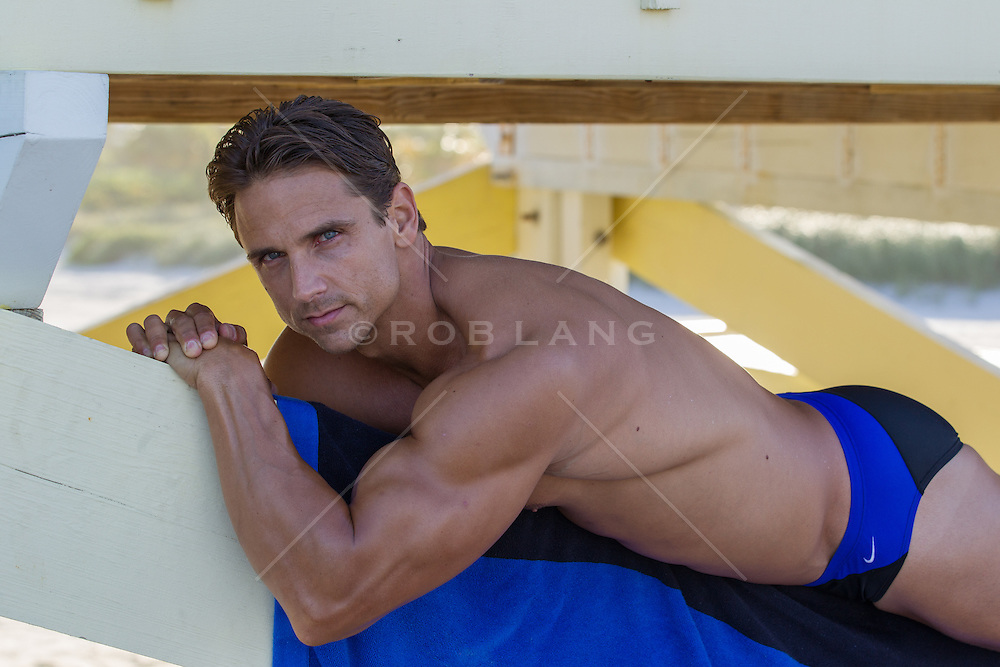 hot man in a speedo on a lifeguard stand