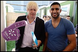 Boris Johnson with Boxer Amir Khan backstage at the Celebration of the 2012 Olympic Games volunteering one year on at the  Queen Elizabeth Olympic Park.<br /> Mayor of London Boris Johnson and Lord Coe will be taking to the stage at Go Local to encourage a new drive in volunteering one year on from the Games. Also present are multi-platinum selling pop rock band McFly; world famous comedian Eddie Izzard, Brit Award nominated The Feeling, and Britain'Got Talent winners Attraction, in addition to stars Jack Carroll and Gabz. The event will be the UKs biggest ever celebration of volunteering and first Olympic and Paralympic legacy event at Queen Elizabeth Olympic Park.<br /> London, United Kingdom<br /> Friday, 19th July 2013<br /> Picture by Andrew Parsons / i-Images