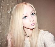 There's a new 'Human Barbie' in town: Another real-life doll - from same city as controversial 'racist space alien' Valeria Lukyanov - becomes internet sensation<br /> <br /> 'Human Barbie' Valeria Lukyanov, 28, might want to look out, as a real-life Skipper - that's Barbie's little sister, don't you know - may be about to steal her crown.<br /> Alina Kovalevskaya, 21, is a walking, talking doll who is on the hunt for her 'real-life Ken'. <br /> The doll-like beauty has made a splash online, with her YouTube videos attracting hundreds of thousands of views.<br /> <br /> She has a devoted band of followers on Russian social network VK, and is frequently bombarded with autograph requests, declarations of love and even marriage proposals - but says that she is still looking for her perfect man.<br /> The 21-year-old is is from Odessa in the Ukraine - the same city as real-life Barbie Valeria.<br /> <br /> The pair were previously friends, but their relationship has since soured.<br /> Strangely Odessa has become a Barbie look-alike hotspot, with several others besides Alina and Valeria attempting to achieve the doll-like look, leading locals to refer to the obsession as 'Barbie-flu'.<br /> Valeria is known for her unique look - including her tiny 18-inch waist - and controversial views about ethnicity, which have seen her branded a 'racist space alien'.<br /> <br /> In an interview with GQ she claimed that interracial couples are making the human race uglier and causing a rise in plastic surgery, which, understandably, sparked a huge backlash.<br /> Valeria's younger - and so far, less controversial - rival Alina has metre-long blonde hair and often wears contact lenses that give her a blank, doll-like stare. <br /> <br /> Alina, who also studies psychology and social work at Odessa University, says she would like to have two children and perhaps even adopt a child on day.<br /> <br /> <br /> Valeria first rose to fame in 2012 after her 'spiritual counseling' videos be