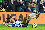 Bernardo Fernandes da Silva Junior (Brighton) falls to the ground in front of the Aston Villa FC supporters during the Premier League match between Brighton and Hove Albion and Aston Villa at the American Express Community Stadium, Brighton and Hove, England on 18 January 2020.
