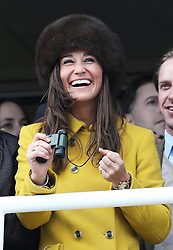 Pippa Middleton watching the racing at Cheltenham Festival, Thursday, 14th  March 2013.  Photo by: Stephen Lock / i-Images