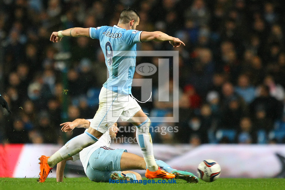 Picture by Paul Chesterton/Focus Images Ltd +44 7904 640267<br /> 08/01/2014<br /> Alvaro Negredo of Man City in action during the Capital One Cup Semi Final 1st Leg match at the Etihad Stadium, Manchester.