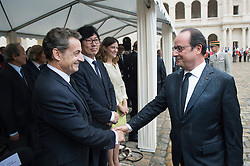 French President Francois Hollande greets former President Nicolas Sarkozy during a national tribute to Harkis - Muslim Algerians who served as Auxiliaries in the French Army during the Algerian War from 1954 to 1962 - at Hotel des Invalides in Paris, France on September 25, 2016. Photo by Chamussy/Pool/ABACARESS.COM