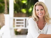 Woman sitting on verandah portrait