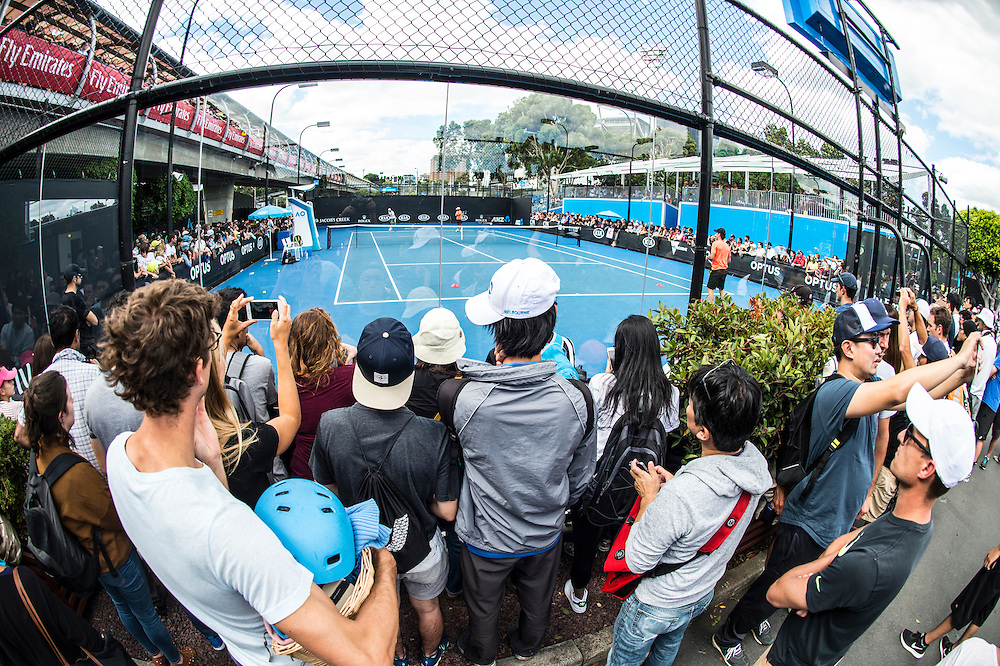 Fans watch Rafael Nadal of Spain practice ahead of the 2017 Australian Open at Melbourne Park on January 14, 2017 in Melbourne, Australia.<br /> (Ben Solomon/Tennis Australia)