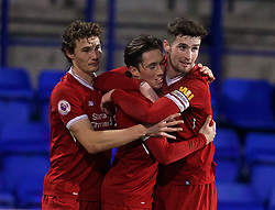 BIRKENHEAD, ENGLAND - Tuesday, December 19, 2017: Liverpool's Harry Wilson celebrates scoring the second goal with team-mate captain Cory Whelan [R] and Matthew Virtue [L] during the Under-23 FA Premier League International Cup Group A match between Liverpool and PSV Eindhoven at Prenton Park. (Pic by David Rawcliffe/Propaganda)