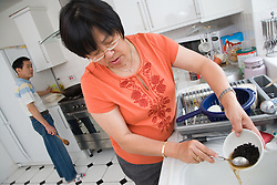Woman making black bean sauce,