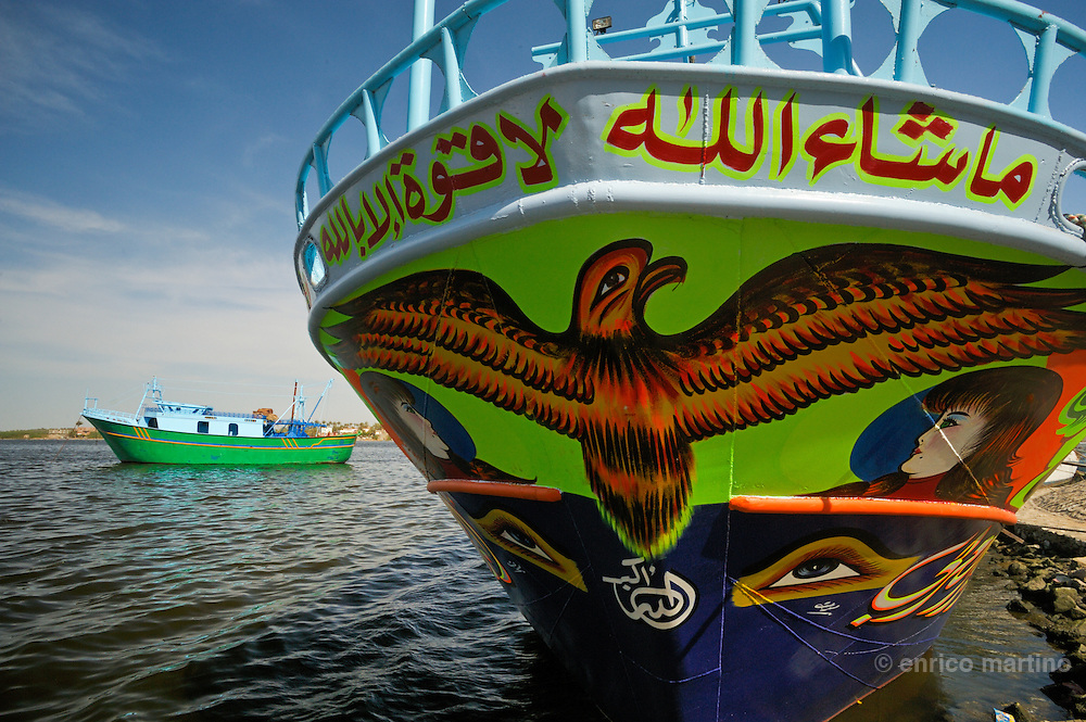Rosetta, Nile river with fishermen boats decorated with naif paintings. Rosetta owes its international fame to the discovery of the famous Rosetta Stone, but in the 18th and early 19th century was Egypt's leading harbour before Alexandria supplanted it.