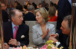Left to right, The French ambassador to the UK GERARD ERRERA, MRS FORBES SINGER and LORD HINDLIP at the annual Chelsea Flower Show dinner hosted by jewellers Cartier at the Chelsea Pysic Garden, London on 22nd May 2006.<br />