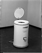 """01/05/1958<br /> 05/01/1958<br /> 01 May 1958 <br /> Electrical equipment for Castle Publications. Frigidaire """"Cascade"""" spin dryer, at Frigidare, 11 Leinster Lane, Dublin."""