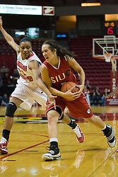 20 November 2010: Sydney Stahlberg drives in against Kenyatta Shelton during an NCAA Womens basketball game between the Southern Illinois-Edwardsville Cougars and the Illinois State Redbirds at Redbird Arena in Normal Illinois.