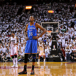Jun 17, 2012; Miam, FL, USA; Oklahoma City Thunder small forward Kevin Durant (35) looks on in the final seconds of the fourth quarter in game three in the 2012 NBA Finals against the Miami Heat at the American Airlines Arena. Miami won 91-85. Mandatory Credit: Derick E. Hingle-US PRESSWIRE